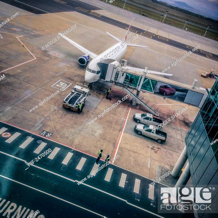 Stock Photo: Passenger jet. Loading and getting ready for departure. Cape Town International Airport.