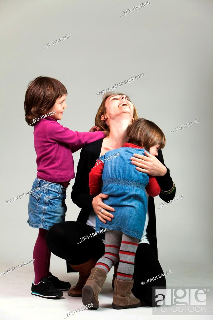 Stock Photo: Woman with his two daughters in a hug.