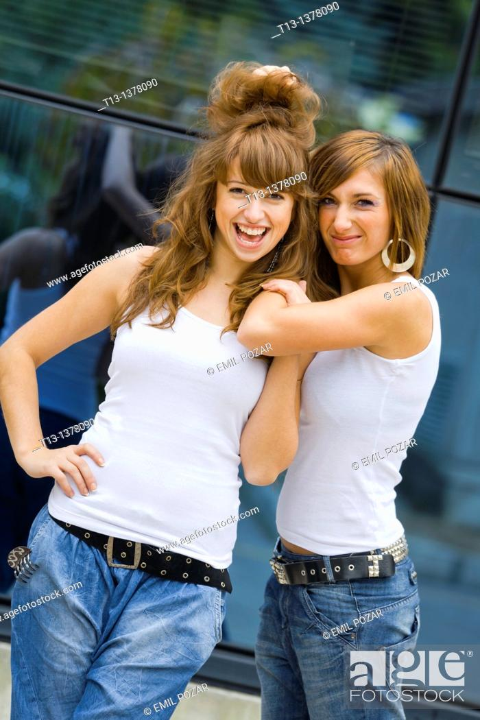 Stock Photo: Two girlfriends in a different mood.