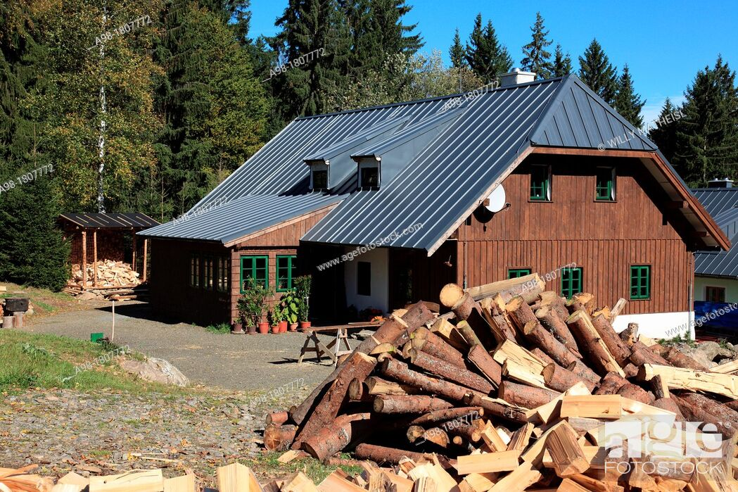 Stock Photo: traditional old farmhouse and firewood at the village Srni, German: Rehberg, Bohemian Forest, National Park Sumava, Czech Republic, Europe.