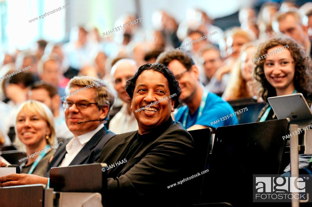 Stock Photo: BAYREUTH/GERMANY - JUNE 21: Stefan Winners (Hubert Burda Media, m.) and Cherno Jobatey (Huffington Post) smile in the audience listening to the speaker during.