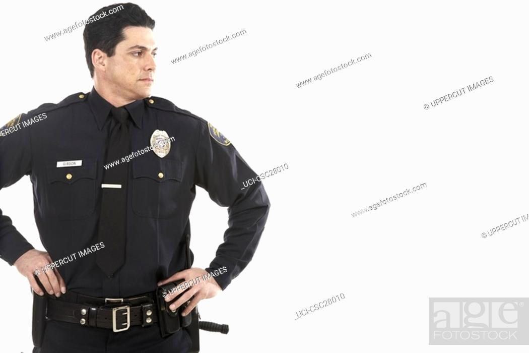 Stock Photo: Male police officer standing with hands on hips.