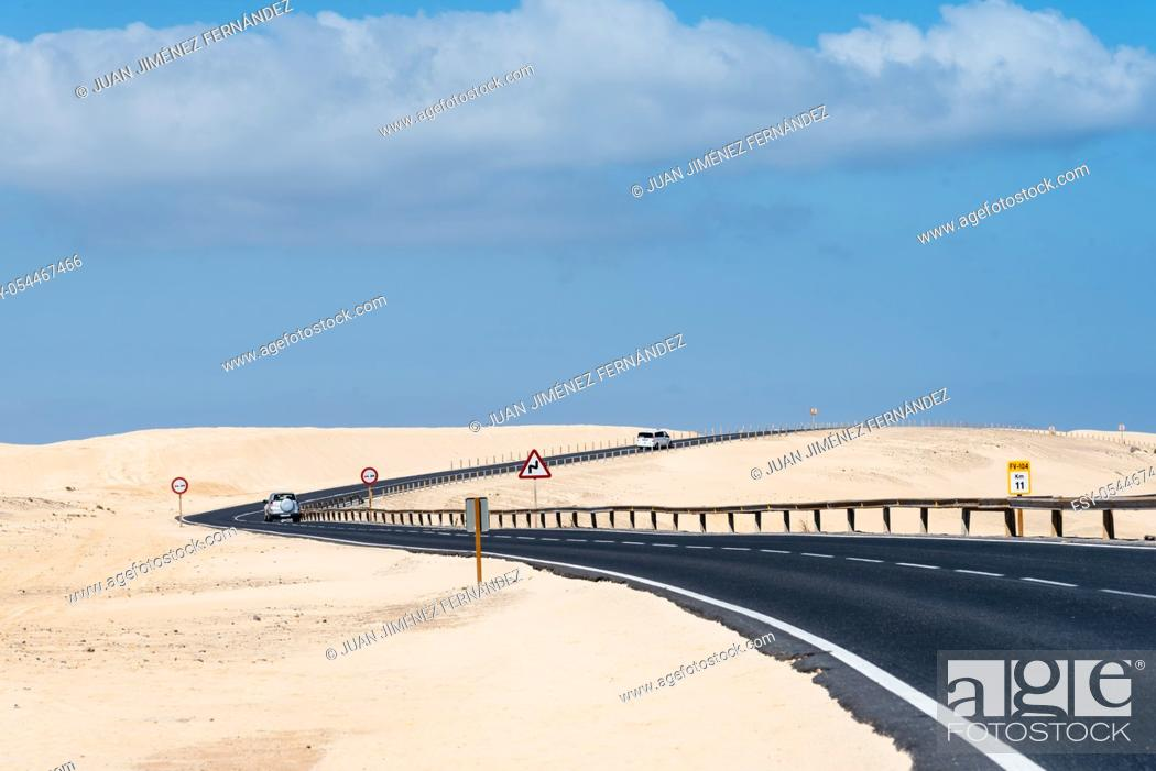 Stock Photo: Scenic view of road through sand dunes against sky. Corralejo, Fuerteventura, Canary Islands.