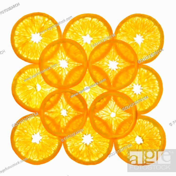 Stock Photo: Orange slices arranged in square design on white background.