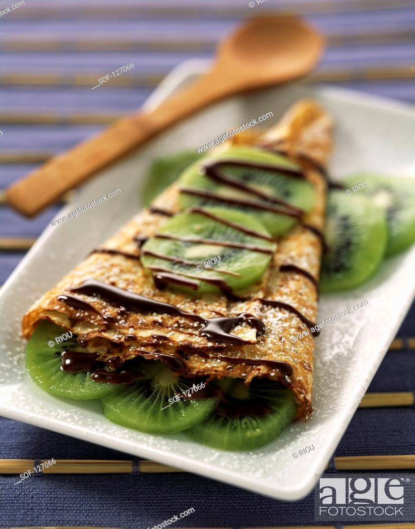 Stock Photo: Pancake with melted chocolate and kiwi.