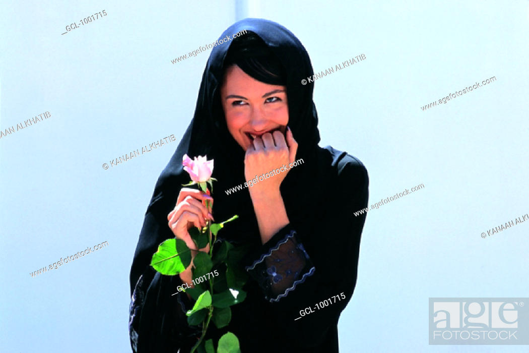 Stock Photo: Woman with a rose.