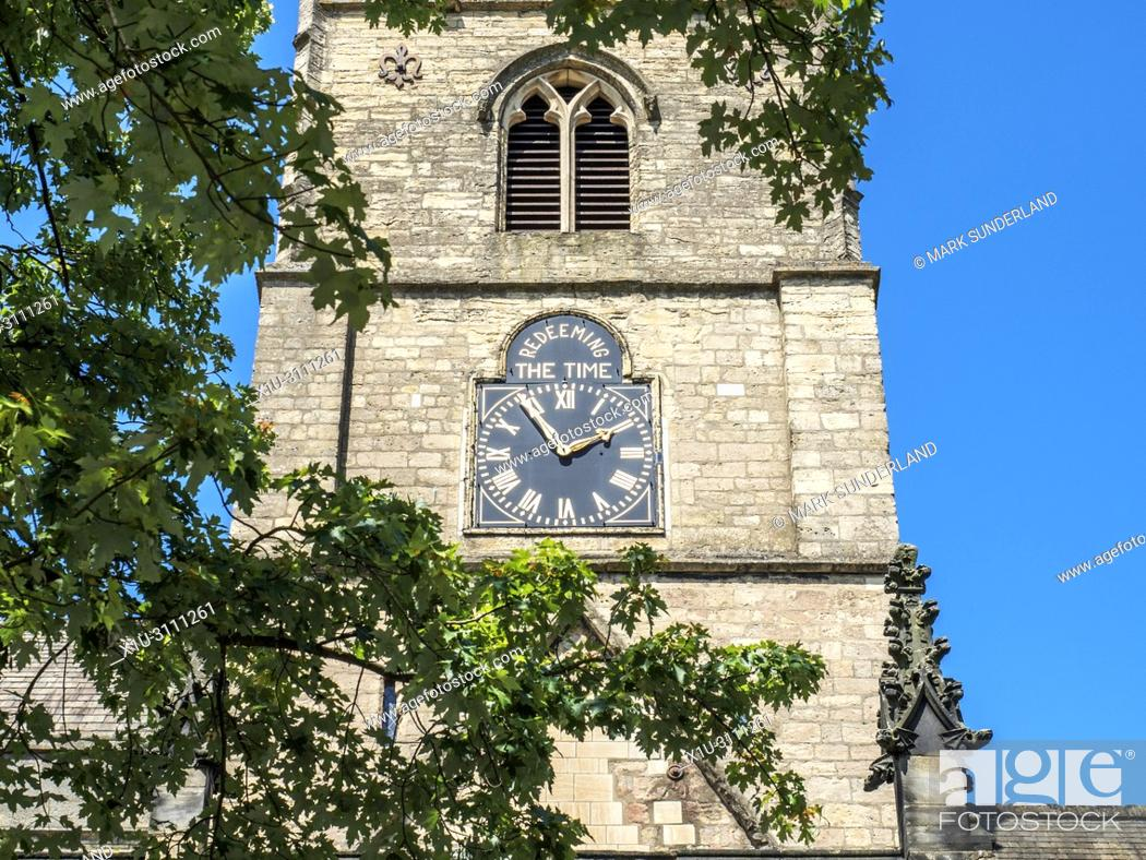 Stock Photo: The tower at St Johns church with the Redeeming the Time inscription above the clock Knaresborough North Yorkshire England.