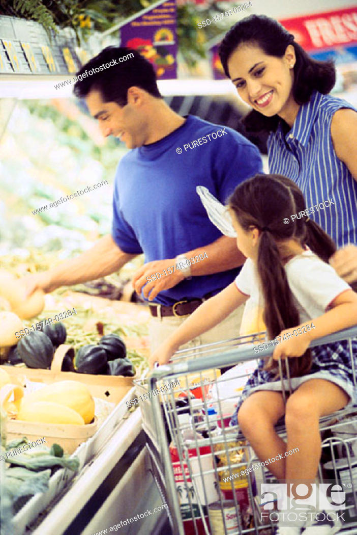 Stock Photo: Parents and their daughter shopping in a supermarket.