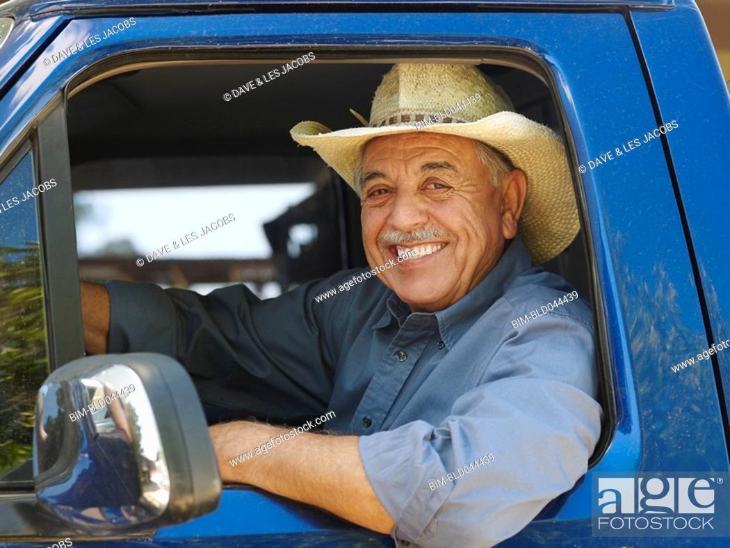 Stock Photo: Senior Hispanic man wearing driving truck.