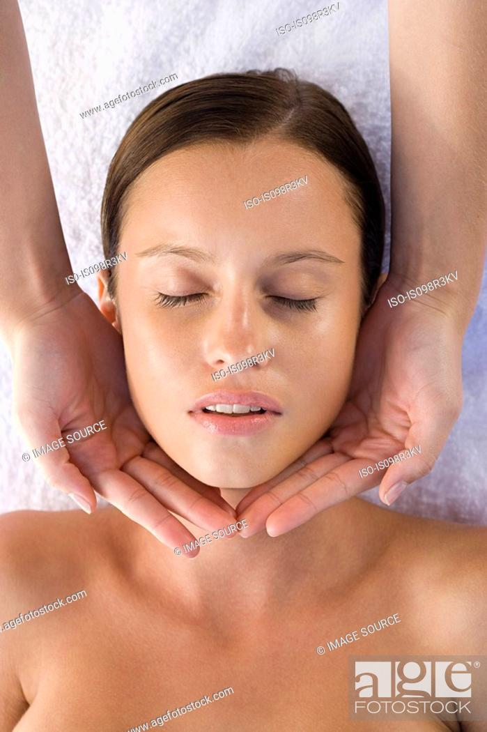 Stock Photo: Young woman receiving facial massage.