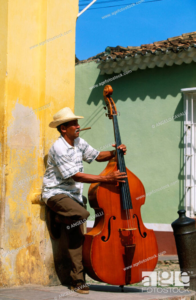 Stock Photo: Bass player in a street of Trinidad de Cuba. Cuba.