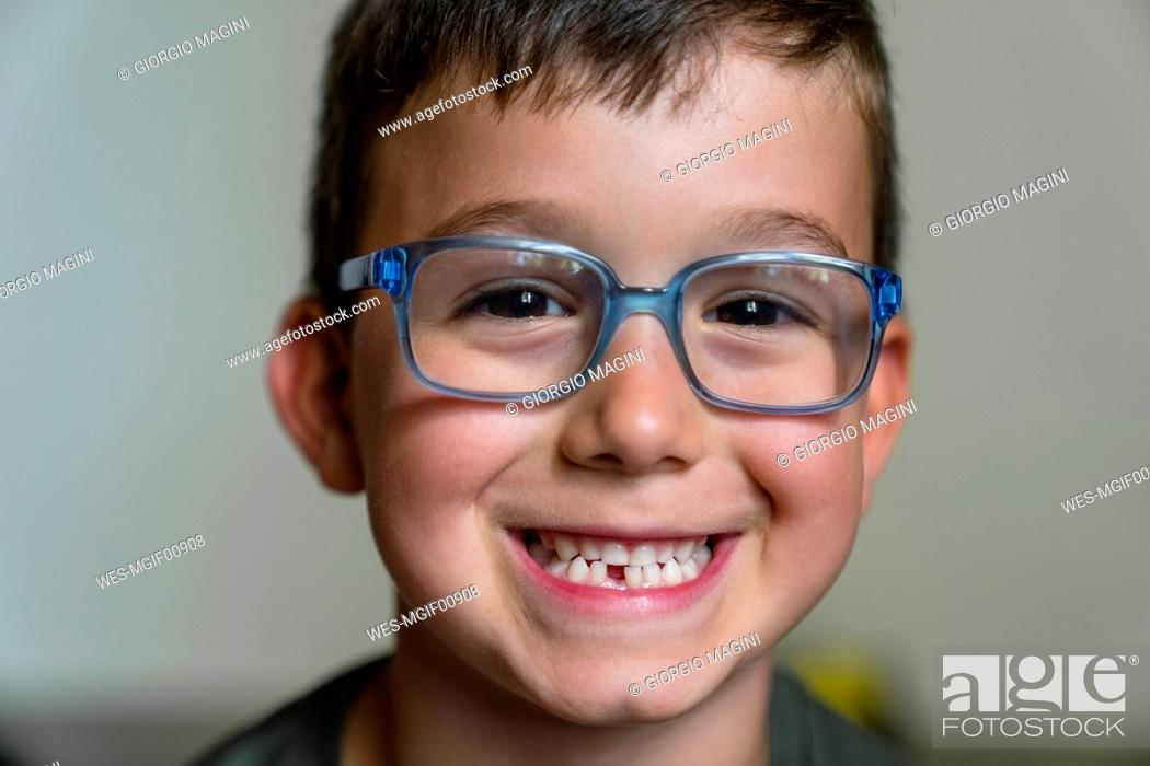 Stock Photo: Portrait of little boy with tooth gap wearing blue glasses.