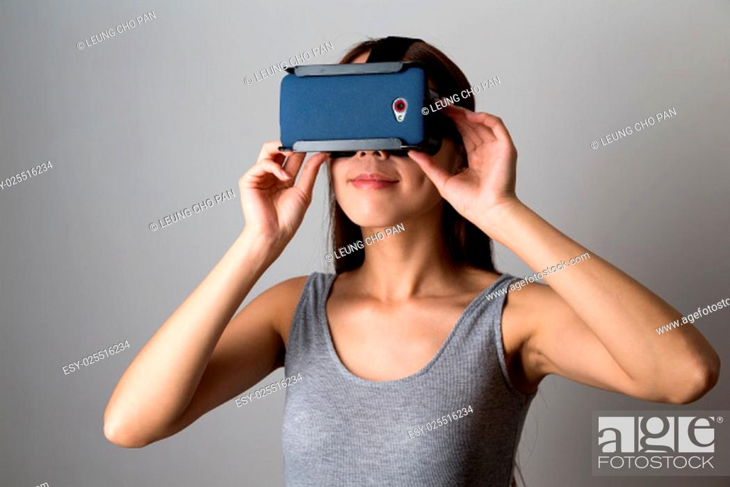 Stock Photo: Young Woman using the virtual reality equipment.