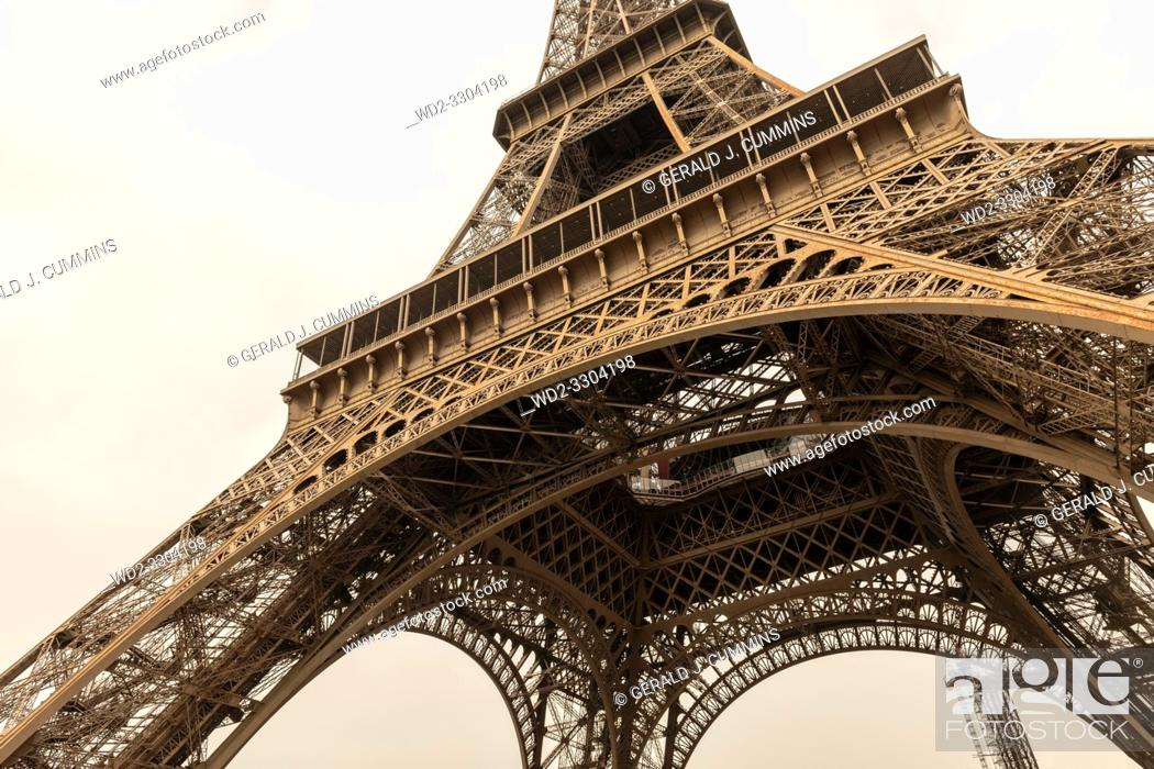 Stock Photo: The tower is 324 metres tall, and the tallest structure in Paris. Its base is square, measuring 125 metres on each side. During its construction.