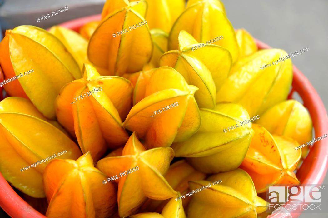 Stock Photo: starfruit for sale, klong toey market klong toei , bangkok, thailand.
