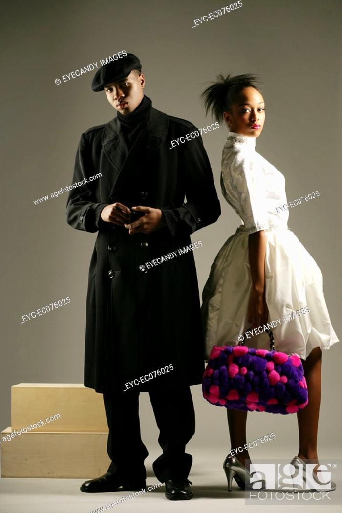Stock Photo: Young stylish African American couple, studio shot.