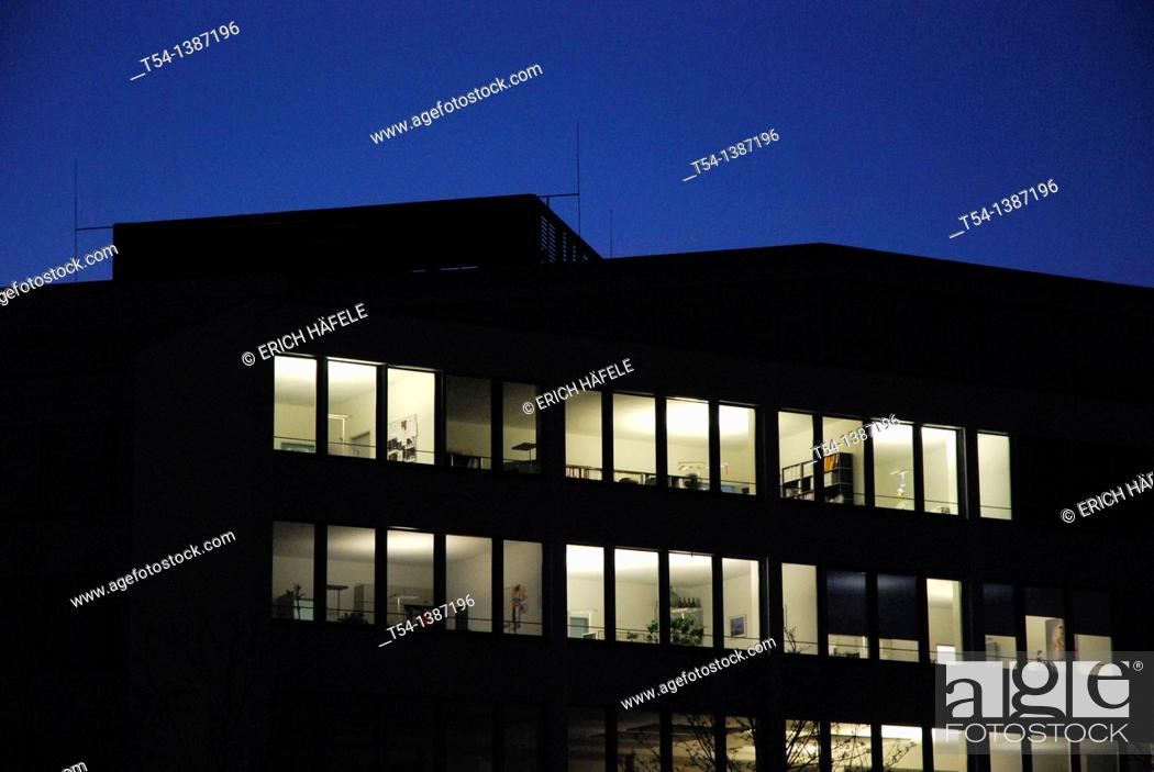 Stock Photo: Burning lights in an office complex.