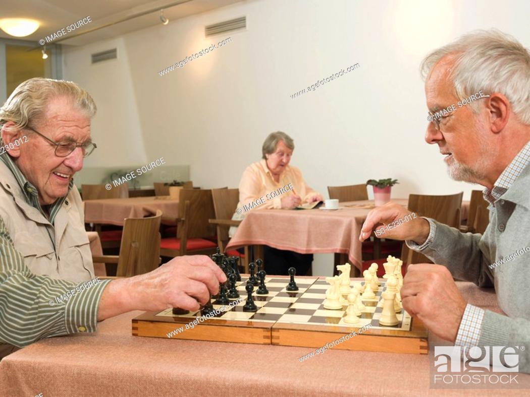 Stock Photo: Senior men playing chess.