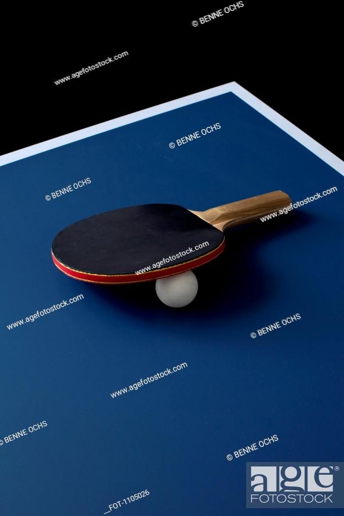 Stock Photo: A table tennis bat and ball on a table.