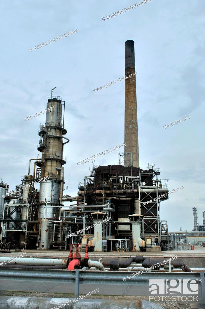 Stock Photo: Oil refinery. Crude oil, or partially refined oil, is refined here into its component parts such as petrol and raw materials for the chemical industry.