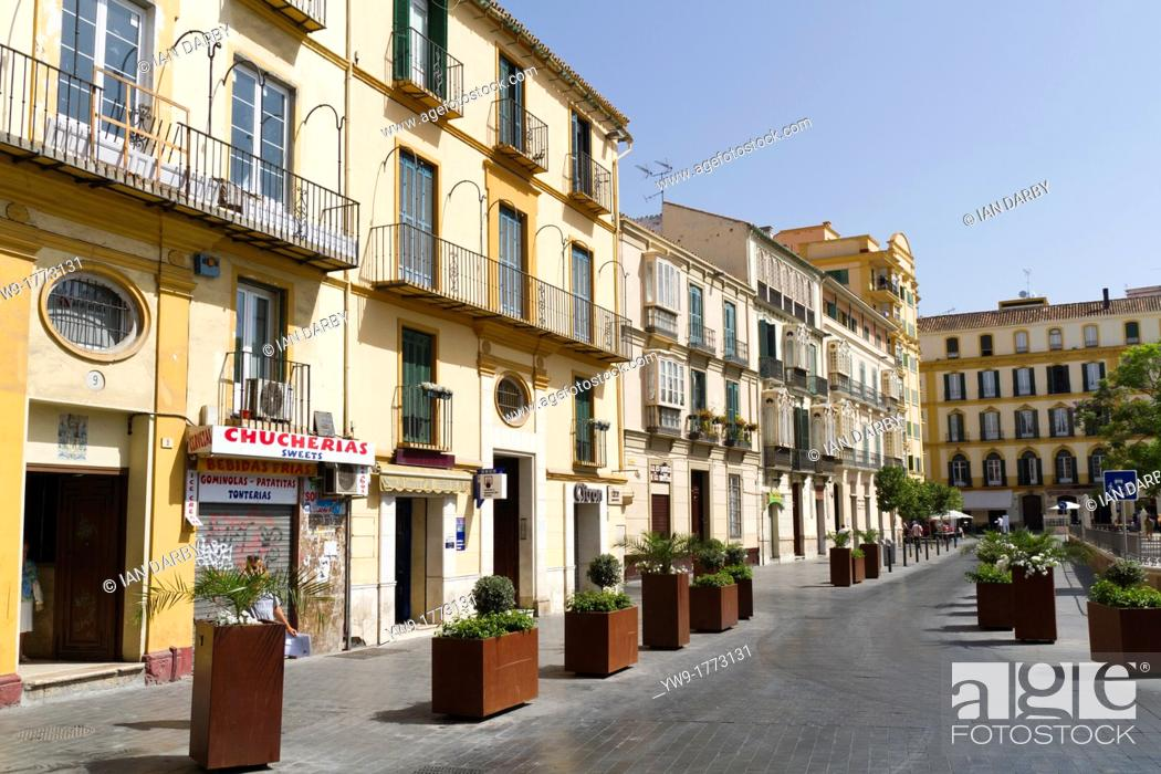 Small shops below apartments in the malaga old town spain for Apartments with shops below