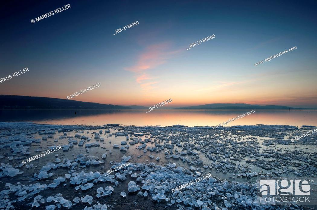 Stock Photo: Chunks of ice lying on icy surface on the shore of Reichenau Island after sunset, Baden-Wuerttemberg, Germany, Europe.