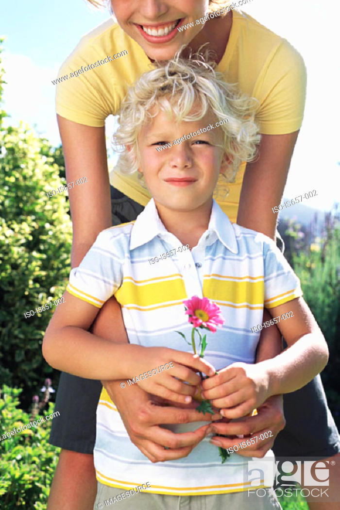 Stock Photo: Mother and son with flower.