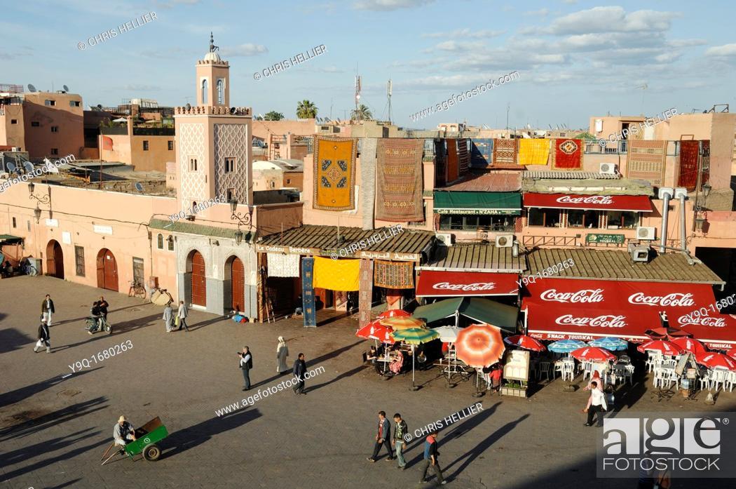 Stock Photo: Restaurants & Shops at Djemaa El-Fna or Jemaa el Fna Square Marrakesh or Marrakech Morocco.