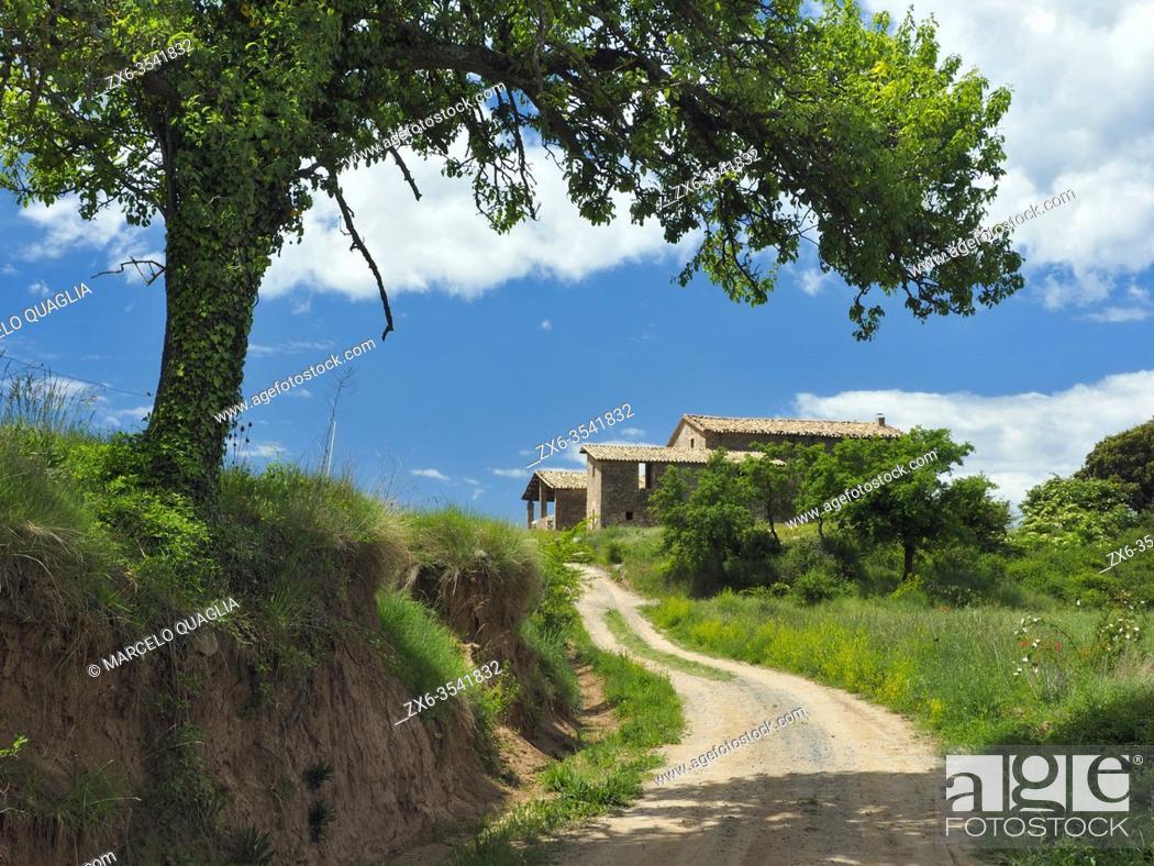 Stock Photo: Dirt road leading to farmhouse. Lluçà village countryside. Lluçanès region, Barcelona province, Catalonia, Spain.