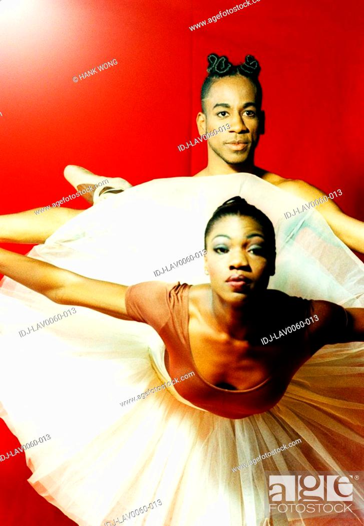 Stock Photo: Two ballet dancers practicing in a studio.