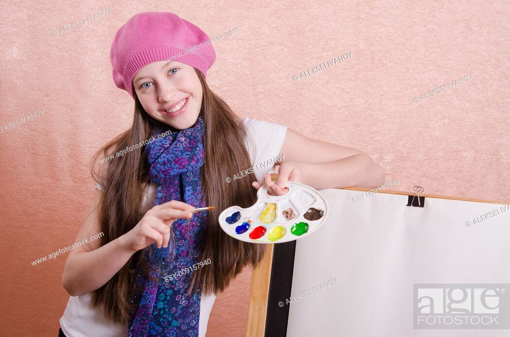 Stock Photo: Twelve year old girl draws a picture on the easel.