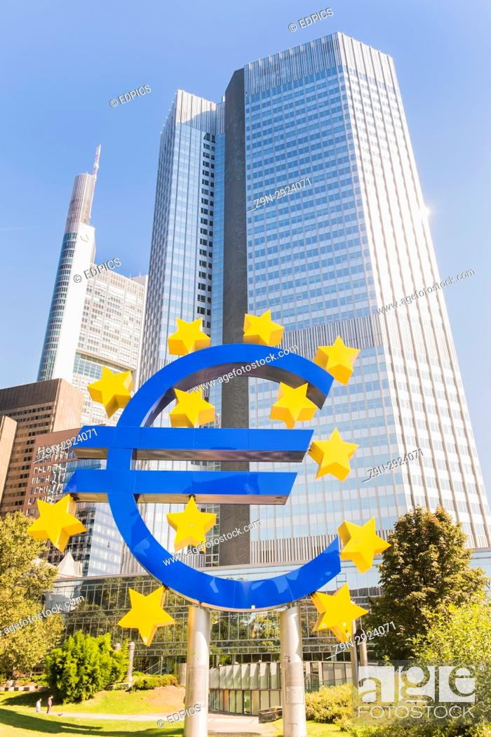 Stock Photo: euro symbol in front of eurotower european central bank building in frankfurts central business district, frankfurt am main, hesse, germany.
