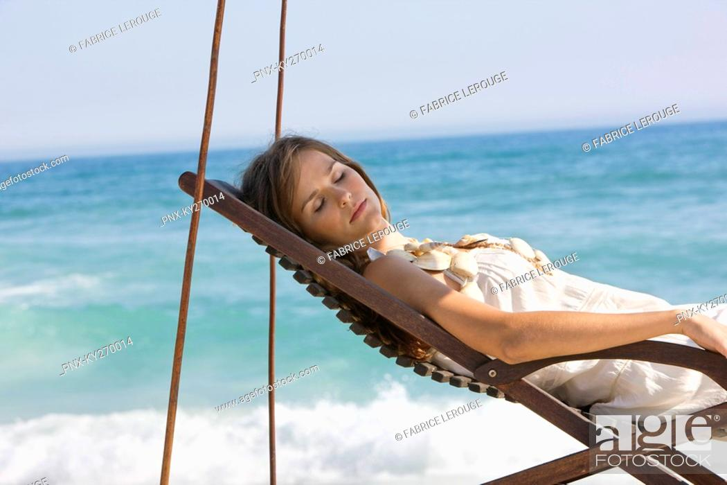 Stock Photo: Woman resting in a deck chair.