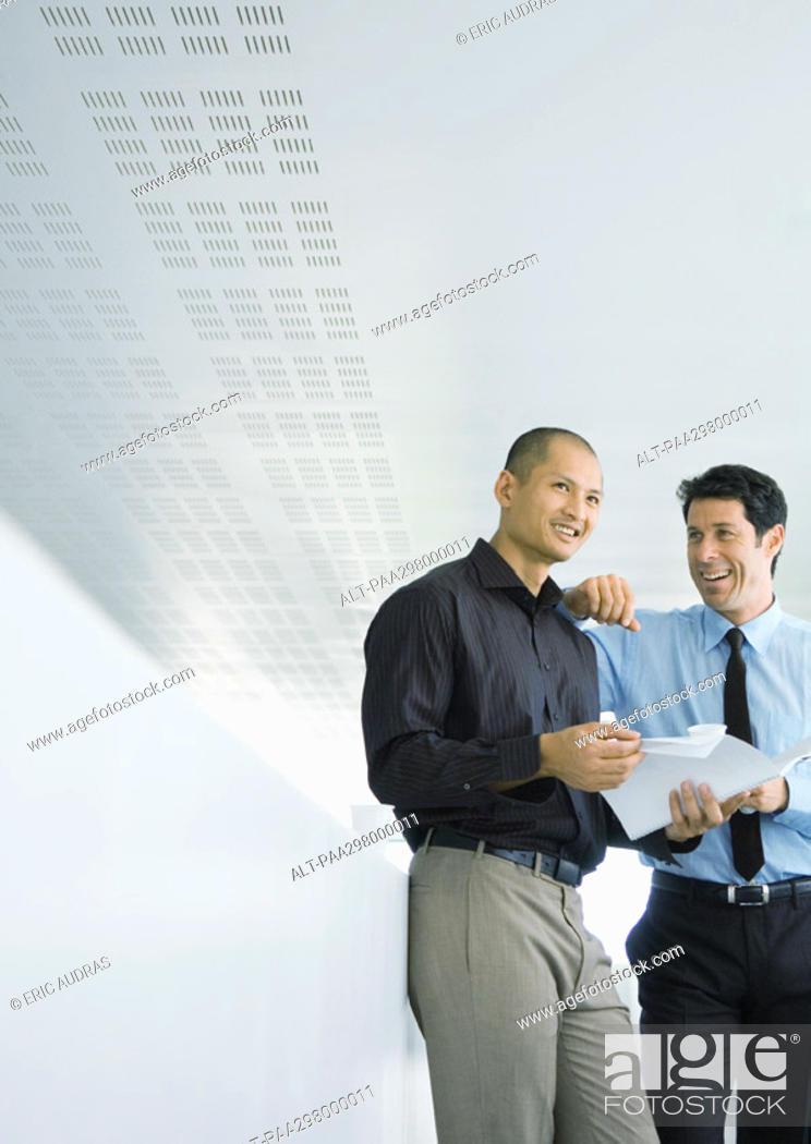Stock Photo: Two businessmen smiling.