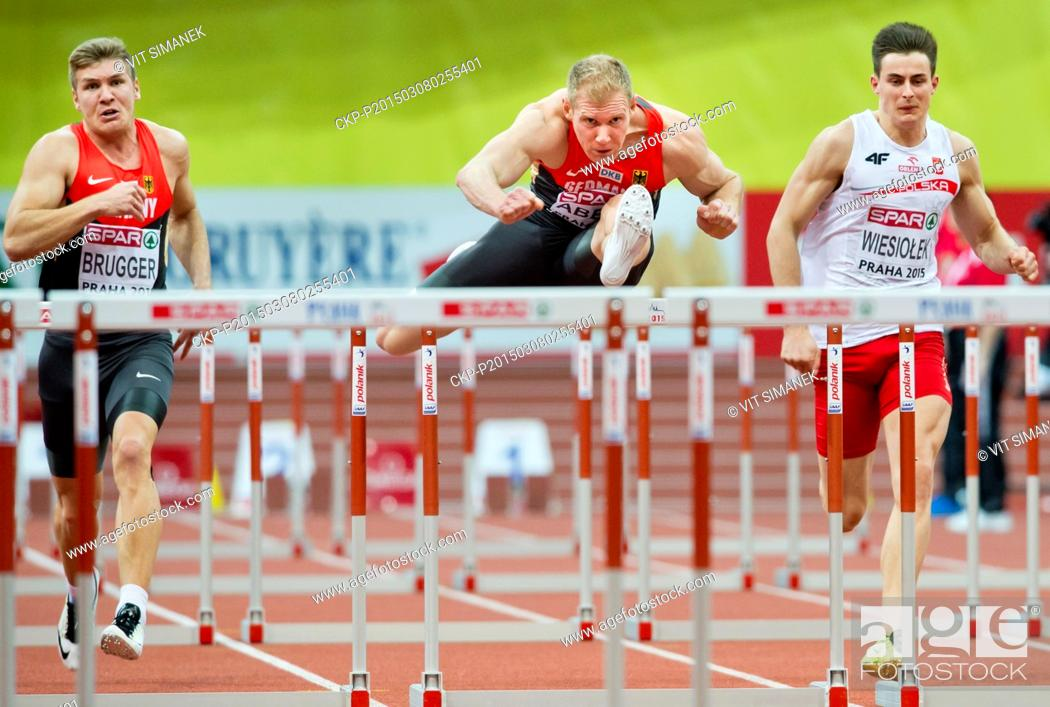 Stock Photo: From left Germany's Mathias Brugger and Arthur Abele and Poland's Pawel Wiesiolek clear a hurdle in the 60m hurdles of the men's heptathlon during the European.