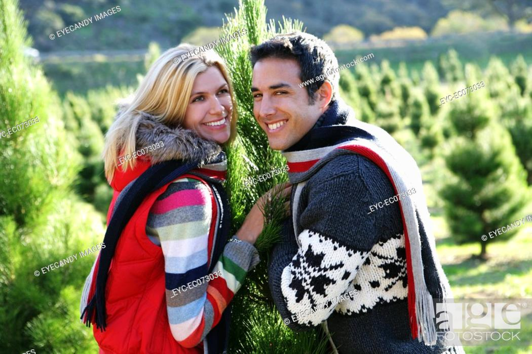 Stock Photo: Young couple picking out Christmas tree.