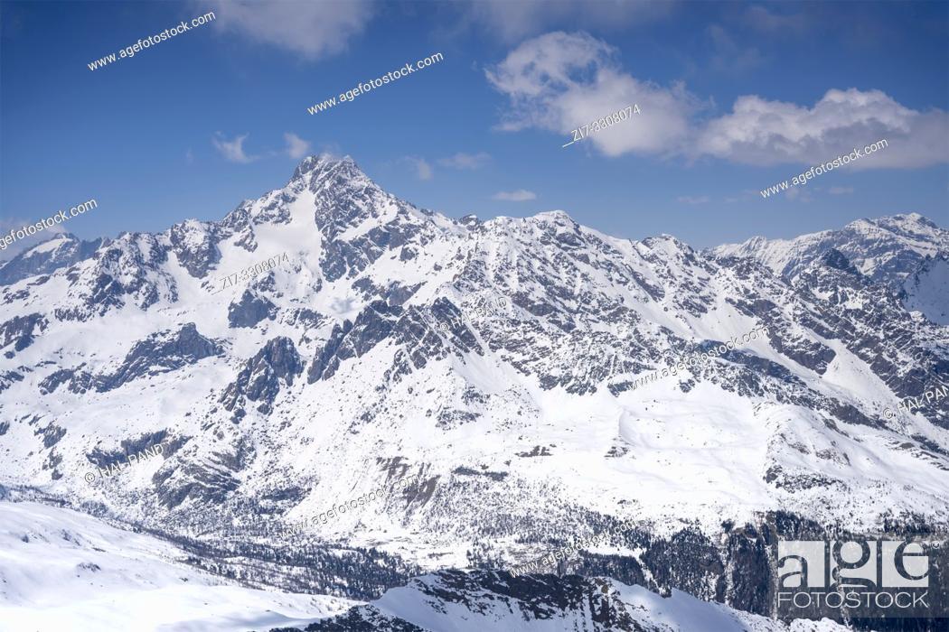 Stock Photo: aerial, from a small plane, of Bernina peak range in Valtellina mountains, shot in bright springtime light, from Chiavenna valley, Sondrio, Lombardy, Italy.