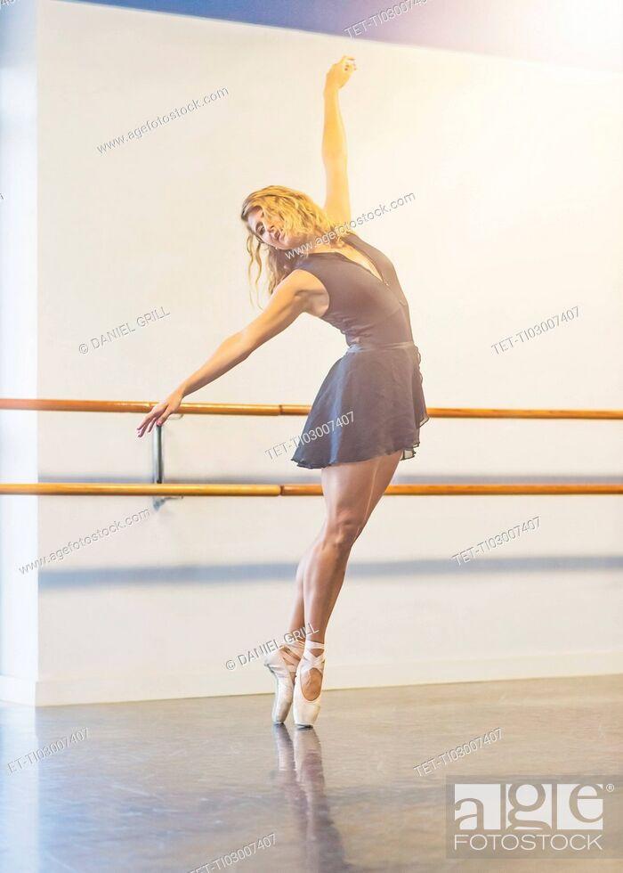 Stock Photo: Young woman dancing in dance studio.