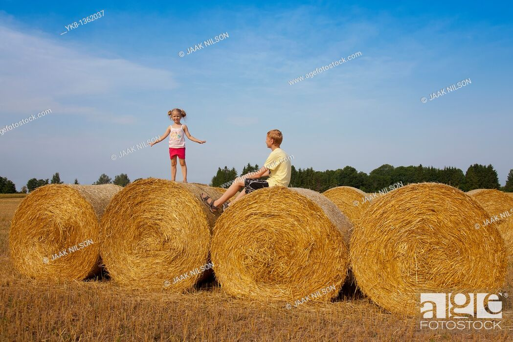 Stock Photo: Children Playing on Corn Bales, Estonia.