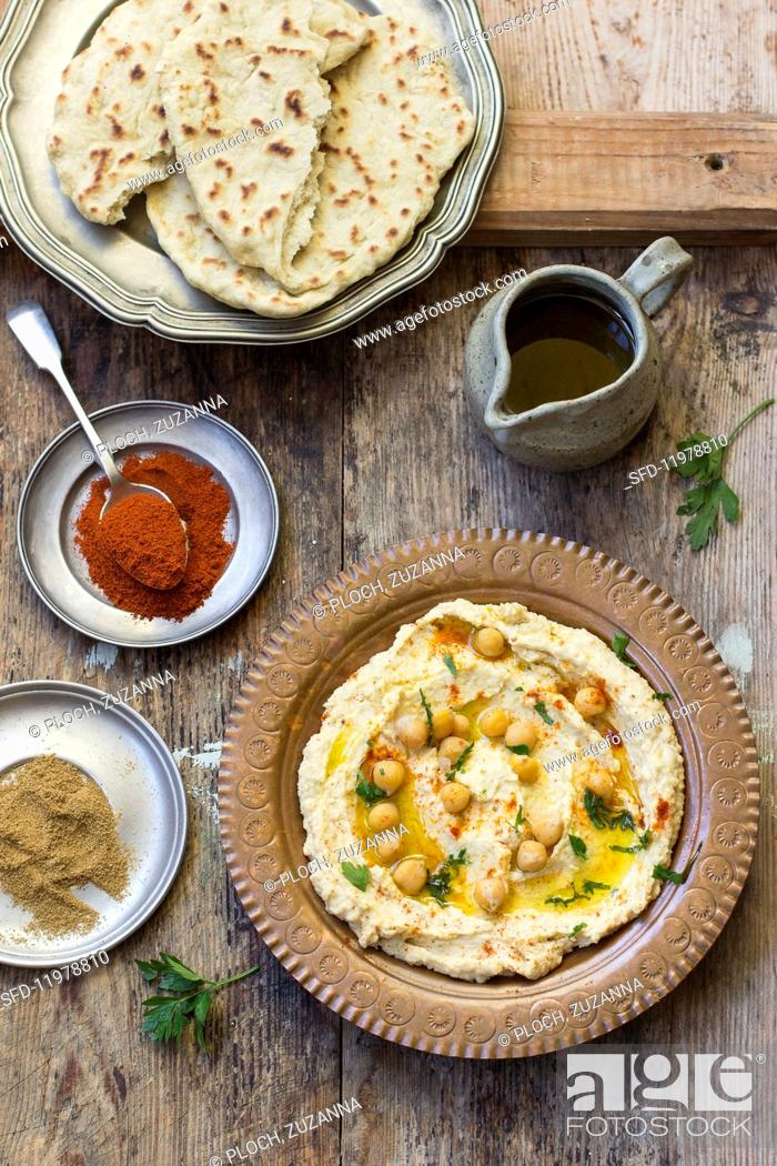 Stock Photo: Hummus and unleavened bread.