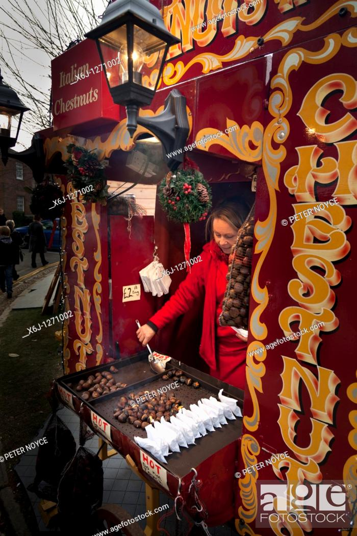 Stock Photo: hot roasted chestnut seller in christmas market.