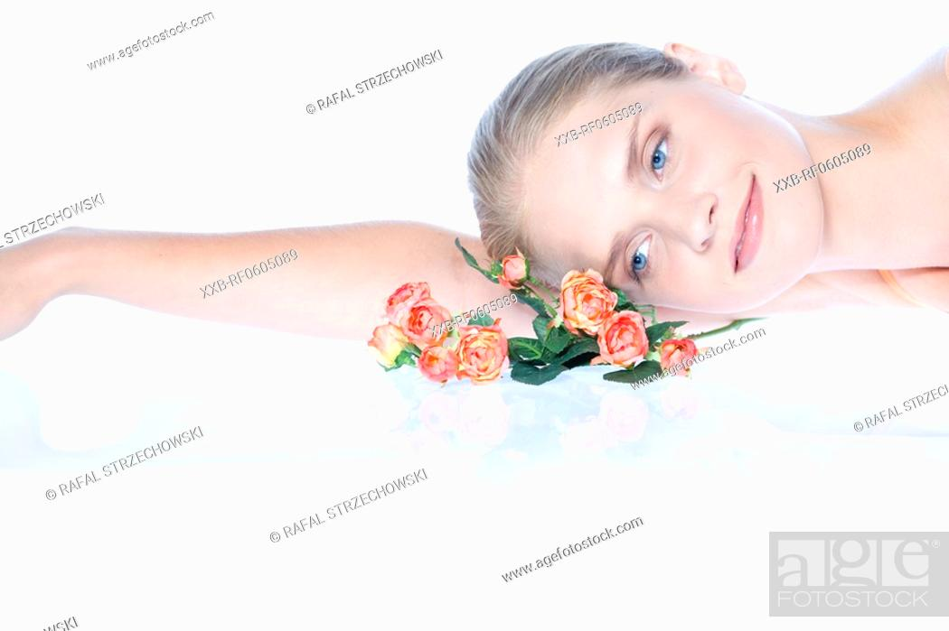 Stock Photo: young woman with roses.