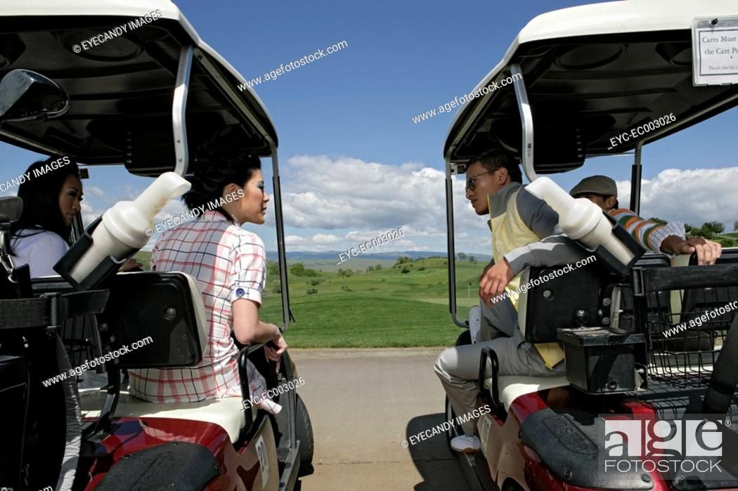 Stock Photo: View of couples talking from their golf carts.