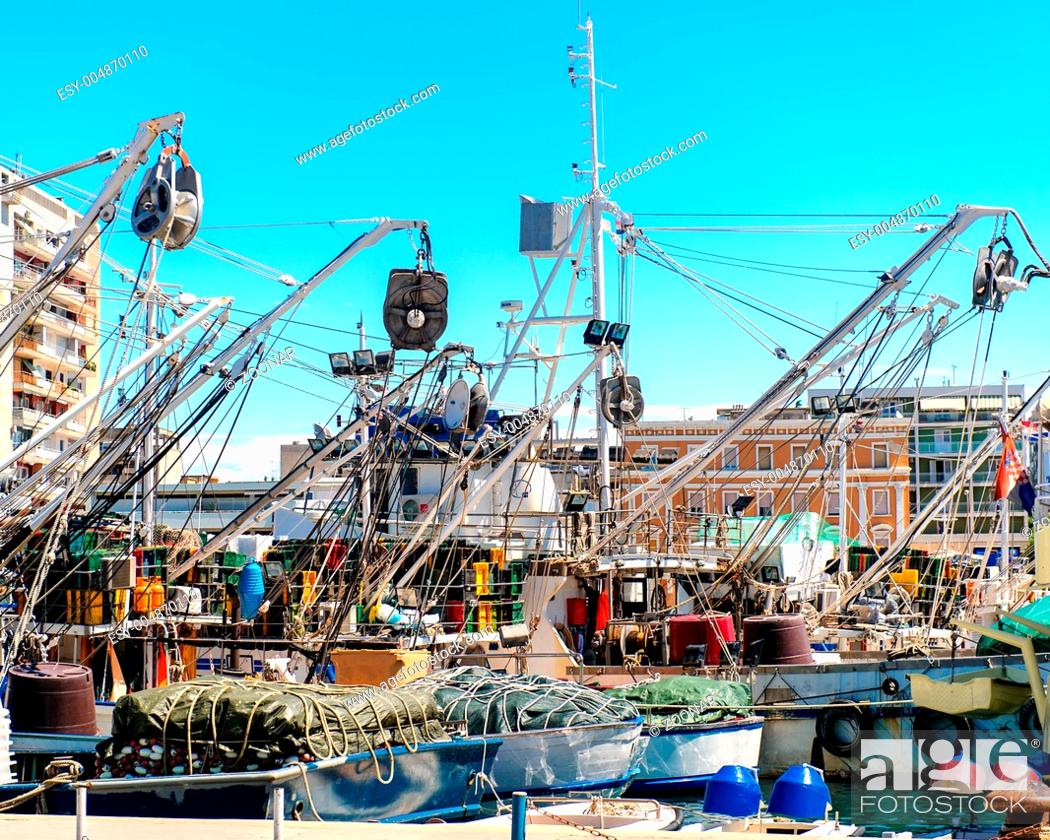 Stock Photo: Fishing ships in the harbor.