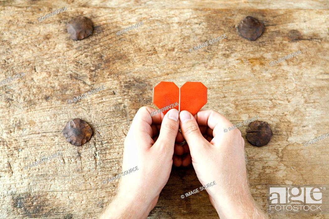 Stock Photo: Person holding origami heart.