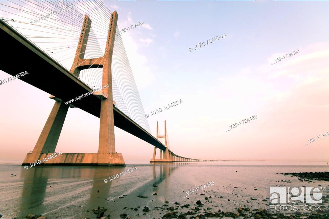 Stock Photo: North towers of Vasco da Gama bridge on low tide.