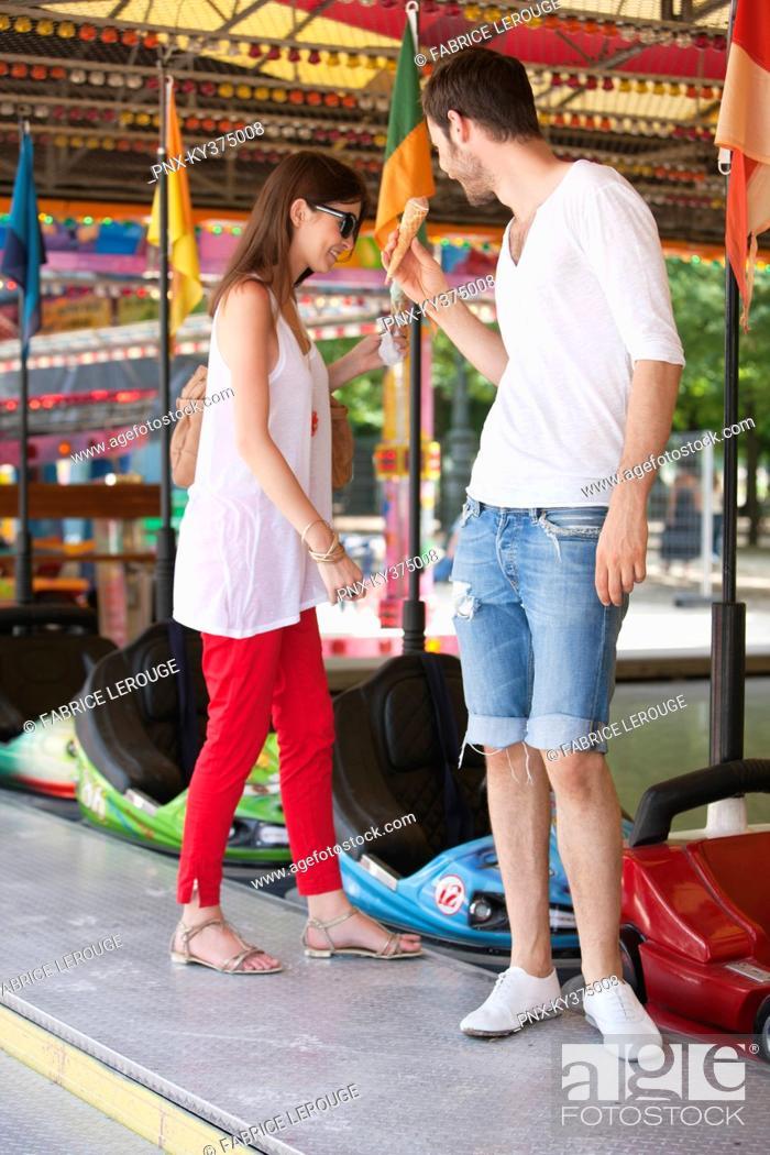 Stock Photo: Couple in an amusement park, Paris, Ile-de-France, France.