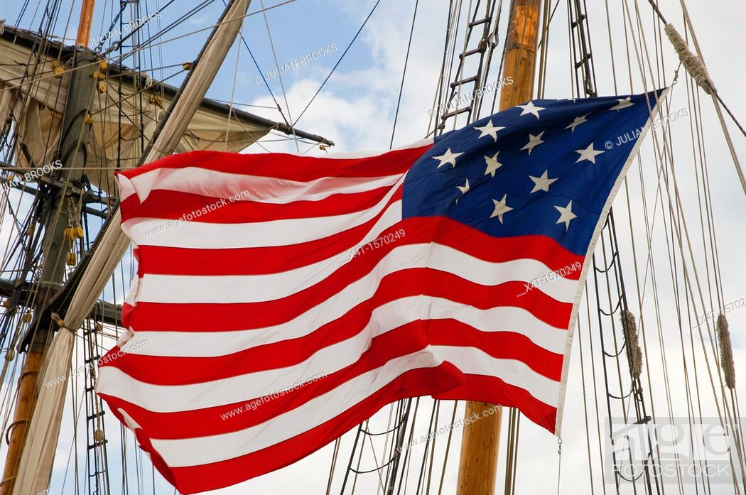 Stock Photo: A fifteen star version of the American flag, flown on a tallship.