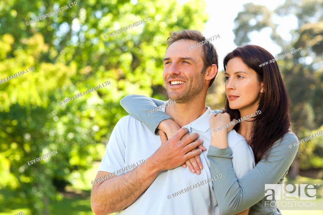 Stock Photo: Beautiful couple in the park.