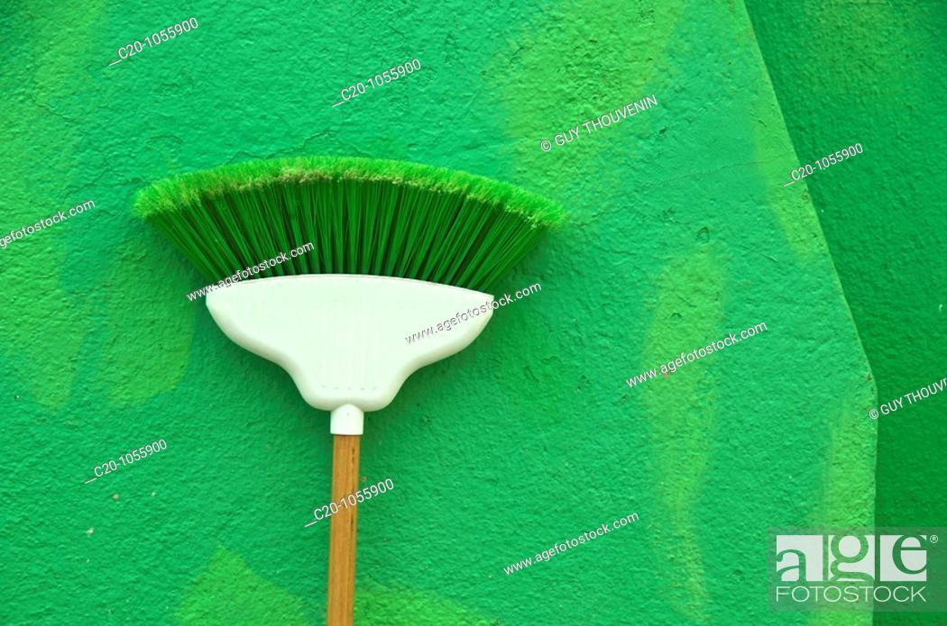 Stock Photo: green broom on green wall ,island of Burano Venice Italy.
